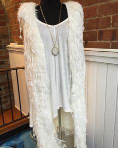 A cool winter white look.  Fringe vest- $39.95 White top- $28 Statement necklace- $18.95  #madisonsbluebrick #downtownhotsprings #winterwhite #winterfashion #fringe