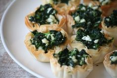 2 cups of frozen spinach  1/2 cup of feta cheese  1 garlic minced  1 egg  1 package of organic mini phyllo shells  Directions:  Preheat oven to 350 degrees  Mix egg, feta and garlic in a bowl  Defrost frozen spinach in a pot of warm water. Squeeze out excess water  Stir spinach into the mixture  Use a spoon to scoop about a tablespoon of the mixture into each phyllo shell  Bake for 8 minutes.