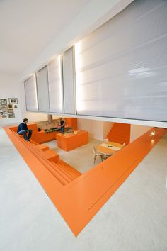 Parksite This former ambulance garage in the centre of Rotterdam borders on a secluded park. Replacing the rear wall with a large glass window creates a direct relationship to it.  #orange #kitchen #dugout #  www.doepelstrijkers.com