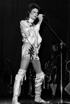 David Bowie in concert at the Hammersmith Odeon, London, during the last performance he made in the guise of his character Ziggy Stardust.