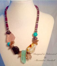 """""""Magnificent Marsala"""". This pink and burgundy necklace by Alexandra Marshall with asymmetrically placed chunky Agate, Turquoise, Rose Quartz, Rock Crystal, & Garnet gemstones has been awarded Top Ten in Beadaholic's Design Contest. 18"""" long with lobster clasp and 3"""" extender chain, it can be yours for only $109. Double click photo to order."""