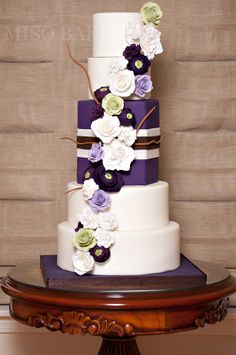 white cake with dark purple tier from miso bakes...