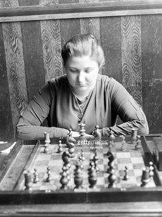 Czech champion Miss Menchik is playing chess in July 1929 in Paris, France. How To Play Chess, Theatre Posters, Chess Players, Amazing Places, Paris France, Puzzles, Masters, Board Games, The Good Place
