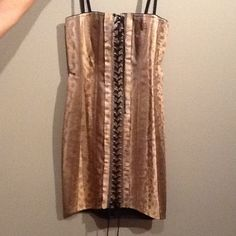 HOST PICON SALE Dolce & Gabbana dress Real snake skin Dolce & Gabbana dress. Never worn. Tags still attached! I AM PRACTICALLY GIVEN THIS AWAY!!!!! GREAT PURCHASE!! Dolce & Gabbana Dresses