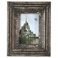 "Vintage wood picture frame with an antiqued frame.  Product: Picture frameConstruction Material: Wood and glassColor: Antique blackFeatures: Holds one 4"" x 6"" photoDimensions: 10.43"" H x 8.46"" WCleaning and Care: Clean with dry cloth"