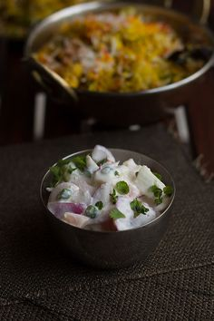 Onion Tomato Cucumber Raita recipe is a famous side dish which goes well with biryanis, pulaos, khichdi or any rice dish. Raitas are healthy and low-fat. Cucumber Raita Recipe, Indian Food Recipes, Ethnic Recipes, Biryani, Rice Dishes, Coriander, Cheeseburger Chowder, Potato Salad, Onion