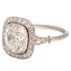 1stdibs | Cushion Cut Diamond Ring: love the delicate nature of this...the halo around center only - my favorite - perfect