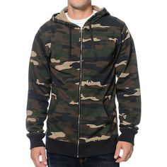 Show just how bad you are with the Zine Camo Me Bad zip up hoodie. This standard fit guys zip up hoodie features an all-over camo print, 3 panel adjustable drawstring hood with metal eyelets, zip up front closure with an exposed metal zipper, contrasting black sleeve cuffs and bottom hem, a super soft fleece lining, cover stitch detailing throughout, and two front hand pockets for storage. Go big at the skate parks in covert style with the Zine Camo Me Bad zip up hoodie.