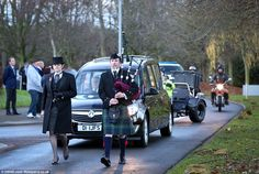 Honours: A piper led the funeral procession which was accompanied by motorcycle outriders...