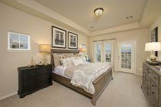Bridgeland Model Townhome - 2,345 Sq. Ft. - Master Bedroom With Balcony - #PerryHomes #trustedbuilder #Bridgeland #Cypress #CyFairISD #CypressHomes #HoustonHomes #masterplannedcommunity #lakes #communityamenities #trails #realestate #openconcept #openfloorplan #interiordesign #townhome #duplex #porch #frontporch #landscaping #balcony #masterbedroom #mastersuite #masterretreat