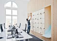 Wooden meeting rooms by Estelle Vincent include a slide