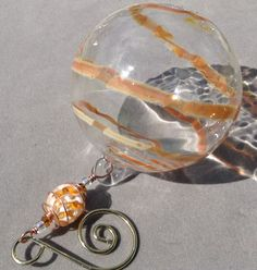 Hand Blown Glass Globe Ornament with Warm Honey by AspenHotGlass, $25.00