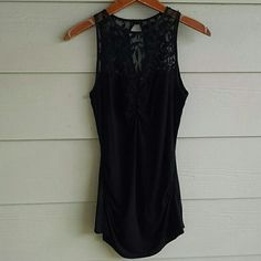 ARDEN B black lace top tank Black lace top shirt. Side rouching and key hole cut out in back with single button closure. Worn one time and in great condition. 93% rayon 7% spandex Arden B Tops Tank Tops