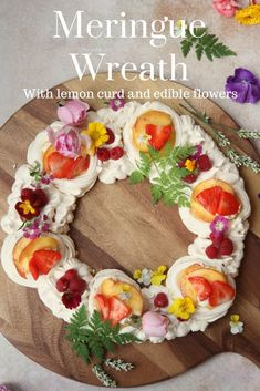 A meringue nest sharing wreath filled with lemon curd and decorated with seasonal edible flowers. Click the link for the simple recipe. Best Dessert Recipes, Easy Desserts, Delicious Desserts, Cake Recipes, Holiday Recipes, Meringue Desserts, Spring Recipes, Fruit Recipes, Dessert Ideas