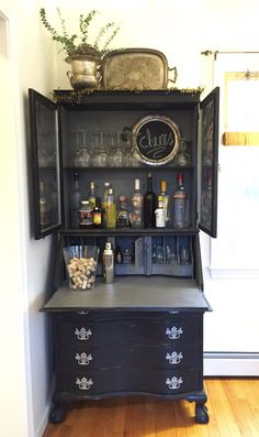 My vintage secretary painted black shabby chic and repurposed as a side bar❤️❤️❤️❤️