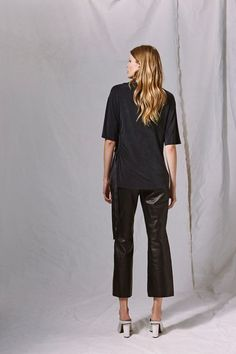39efea0ad35b Feel the minimal power of this cut out t-shirt. With ruched cut out