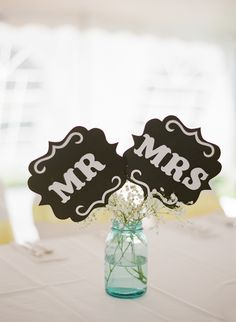 Cute Wedding Signs in this wedding    More on Style Me Pretty: http://www.StyleMePretty.com/2014/02/12/diy-greenwood-hills-country-club-wedding/ The McCartneys Photography