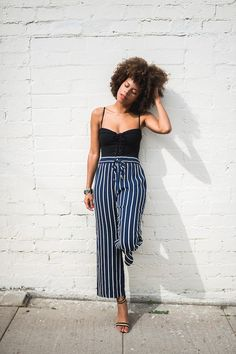 Striped pants. Black lace-up bodysuit+blue striped pants+black and gold ankle strap heeled sandals. Summer Dressy Casual Outfit 2017