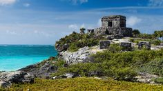 Historic Tulum, one of the few walled Mayan cities, faces the turquoise Caribbean Sea.