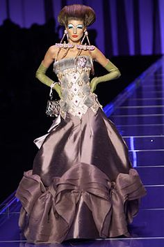 Dior Spring 2004 Couture, John Galliano's Dior couture show was inspired by an aerial tour of Egypt that included the Valley of the Kings, Cairo, Aswan, and Luxor