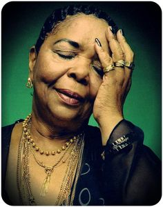 Obsessed with Cesaria Evora's tassled gold.