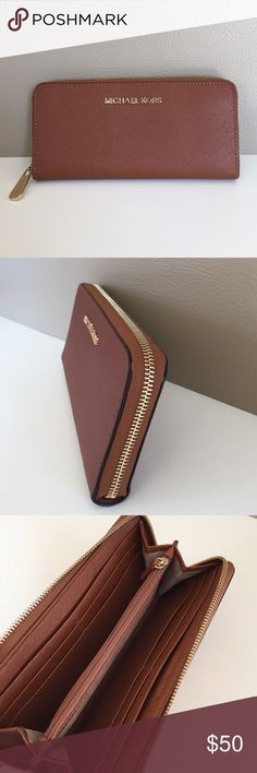 Michael Kors Zip Wallet Zip accordion style wallet in luggage color saffiano leather with gold hardware. Center zip compartment for coin, 8 card slots, 2 bill slip pockets. Hairline scratches on zipper pull. Great condition. Michael Kors Bags Wallets