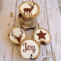 Slices of Wood decorated with Paint and Vinyl Cut outs make great Christmas Decorations or unusual Gift Wrap tags.