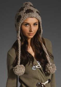 EUGENIA KIM Skye Earflap with Poms in Taupe at Revolve Clothing - Free Shipping!http://www.revolveclothing.com/DisplayProduct.jsp?product=EUGE-WH146=Jewelry+%26+Accessories=C=s