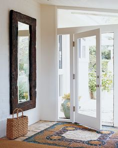 Illuminate the entryway with a wedge-shaped window above the door - hang a Balinese mirror to reflect the garden outdoors and use a pebble mosaic flooring Entryway Mirror, Entry Foyer, Entryway Decor, Door Entry, Entryway Ideas, Entry Tile, Church Foyer, Mirror Door, Casas California