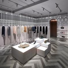 'Compolux' women's clothing floor by nendo for Seibu department store in Tokyo. European wrought iron fences were the inspiration for the, suspended from the ceiling, hanger rack screens.
