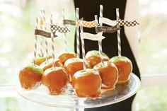 caramel apples on plate with striped sticks and matching pennant flags