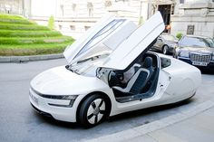 Volkswagen currently the world's most energy efficient car. Most Fuel Efficient Cars, Futuristic Cars, Futuristic Vehicles, Energy Conservation, Sustainable Tourism, Trends, Solar Energy, Renewable Energy, Car Manufacturers
