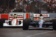 Embedded image permalink Photographed by Tony Famularo. If you pin this please do not remove my name.  The last great battle. Adelaide 1992. Ayrton Senna & Nigel Mansell. #Neverforgotten