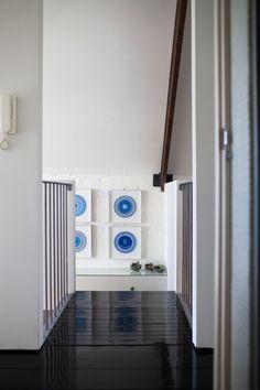 TDF Open House - Upstairs hallway featuring artwork by Lucas Grogan.  Photo - John Deer.