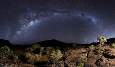 The band of the Milky Way arcs above volcano Piton de la Fournaise, Reunion Island - Luc Perrot