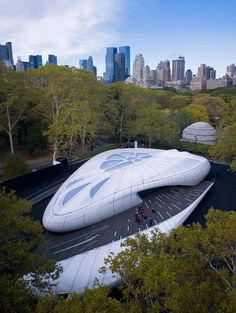 Chanel Mobile Art Pavilion - Paris, France / Zaha Hadid, Architect.  This design was inspired by a Chanel handbag.