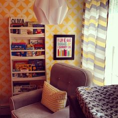 Gray and yellow nursery featuring stenciled yellow accent wall