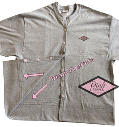 I lived in this T-shirt when I was healing from my mastectomy. I designed it for myself but think others could really benefit from it as well. It is PERFECT for sleeping in. The inside pockets at the bottom of the T hold up to 3 drains on each side. They keep the drains in place and help keep your comfort level high. It has soft snaps in the front for easy on-off, and to get to your drains easily. I suggest buying 2, and alternating each day for the first week after your surgery. These Ts…