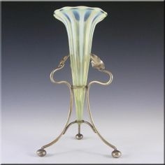 A stunning Victorian 1890's glass epergne vase with silver plated base / holder. Made in Vaseline/Uranium yellow glass, which glows bright green in UV light! Also has vertical white Opalescent stripes. Most likely made by one of the British glass factories from the Stourbridge area of England, such as John Walsh Walsh, Richardson or Thomas Webb.