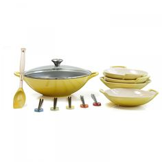 Prepare delicious Asian inspired cuisine with this Le Creuset wok set. This set includes one wok, four wok dishes, five bamboo chopsticks, five stoneware chopstick rests, and a silicone saute spoon perfect for serving.