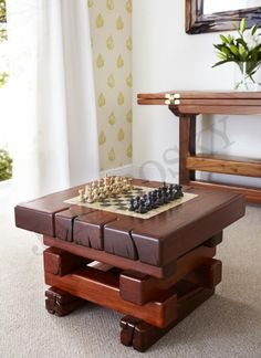 "Jarabosky Hagar games table 27""(690mm)x 27""(690mm)x 19""(480mm)H in Jarrah timber £700 shown with an American marble & onyx chess set priced at £180"