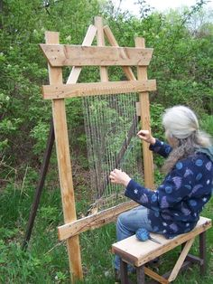 Inspiration to hack together an easel-type support structure for frame looms so I can weave outside comfortably.