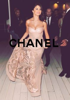 Selena Gomez in this Chanel gown is absolutely beautiful. I love the color, length, and intricate design.