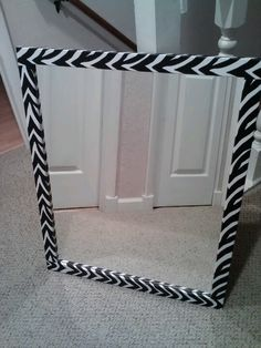 Covered a natural wood framed mirror, with zebra contact paper, to match my daughters zebra themed bedroom!