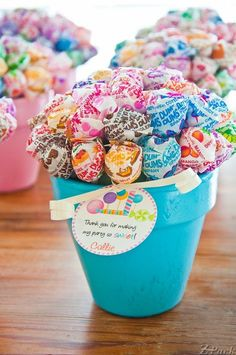 We have some dum dums! lollipop bouquets nestled in little painted pots--perfect party favors! Lollipop Party, Lollipop Bouquet, Party Candy, Lollipop Centerpiece, Party Centerpieces, Babyshower Centerpieces For Boys, Cheap Baby Shower Decorations, Lollipop Decorations, Party Favors