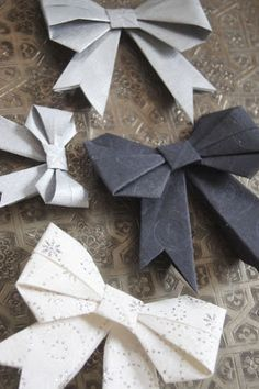 origami bow -   similar folding instructions under http://www.origami-instructions.com/origami-bow.html