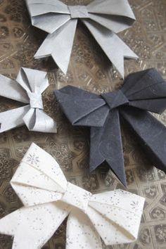 origami bow -   similar folding instructions under http://www.origami-instructions.com/origami-bow.html