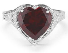 So romantic!  Vintage Filigree Garnet Heart Ring in 14K by Applesofgoldetsy.