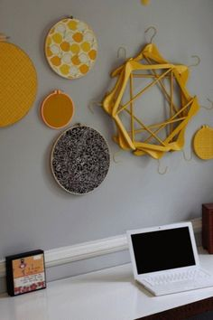 circular wall art made from wooden hangers by keisha