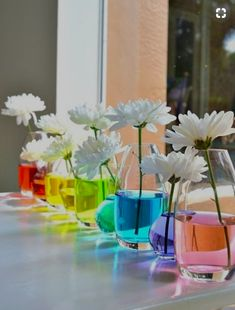 CafeMom.com : Rainbow Flowers : 40 Rainbow Baby Shower Ideas to Celebrate a Little Miracle -- White flowers in food coloring–tinted water can add a sophisticated rainbow look to a windowsill or entryway as guests come in. Diy Baby Shower Decorations, Baby Shower Centerpieces, Flower Centerpieces, Birthday Decorations, Rainbow Theme Baby Shower, Rainbow Baby, Baby Shower Themes, Rainbow Birthday, Rainbow Water